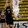 Boulder's Marc Krimstock (right) gets a shot over Fairview's Jacob Larentzen (left)during their basketball game the University of Colorado in Boulder, Colorado January 17, 2011. CAMERA/MARK LEFFINGWELL