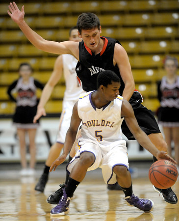 Fairview's Shane O'Neil (back) pressures Boulder's Demetrius Kennedy (front) during their basketball game the University of Colorado in Boulder, Colorado January 17, 2011. CAMERA/MARK LEFFINGWELL