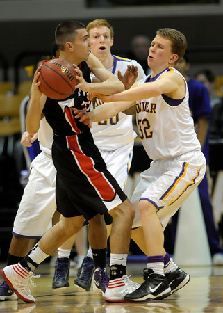 Boulder's Jack Huettel (right) pressures Fairview's Jonah Crespi (left) during their basketball game the University of Colorado in Boulder, Colorado January 17, 2011. CAMERA/MARK LEFFINGWELL