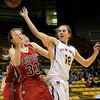 Boulder's Courtney Van Bussum (right) knocks the ball away from Fairview's Sarah Kaufman (left) during their basketball game the University of Colorado in Boulder, Colorado January 17, 2011. CAMERA/MARK LEFFINGWELL