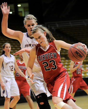 Fairview's Hannah Hyde (right) pushes past Boulder's Ande Lampert (right) during their basketball game the University of Colorado in Boulder, Colorado January 17, 2011. CAMERA/MARK LEFFINGWELL