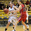Boulder's Courtney Van Bussun (left) tries to get past Fairview's Meghan Higgins (right) during their basketball game the University of Colorado in Boulder, Colorado January 17, 2011. CAMERA/MARK LEFFINGWELL