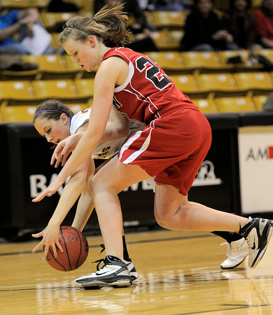 Fairview's Hannah Hyde (right) and Boulder's Courtney Van Bussum (left) dive for a loose ball during their basketball game the University of Colorado in Boulder, Colorado January 17, 2011. CAMERA/MARK LEFFINGWELL