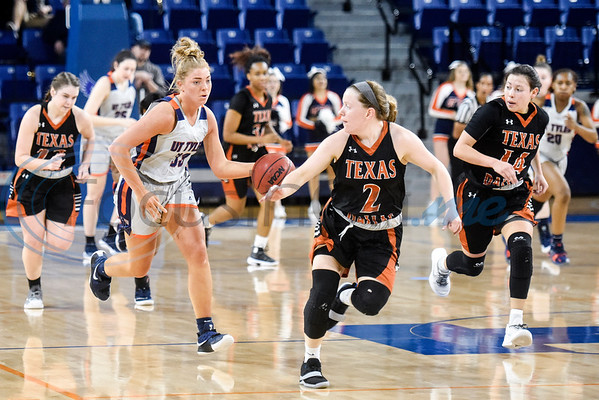 UT Tyler's Carissa Spiker (33) dribbles the ball down the court as UT Dallas players run to guard her during a college basketball game at the University of Texas at Tyler in Tyler, Texas, on Thursday, Jan. 17, 2019. (Chelsea Purgahn/Tyler Morning Telegraph)