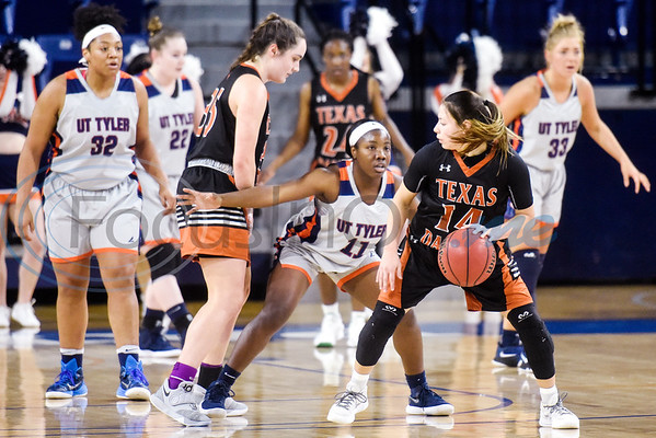 UT Tyler's Tyreesha Blaylock (11) guards UT Dallas' Victoria Pena (14) during a college basketball game at the University of Texas at Tyler in Tyler, Texas, on Thursday, Jan. 17, 2019. (Chelsea Purgahn/Tyler Morning Telegraph)