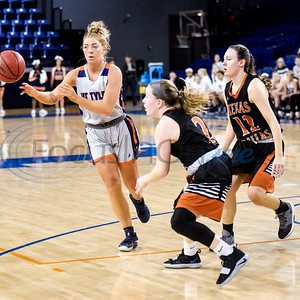 UT Tyler's Carissa Spiker (33) passes the ball to a teammate as UT Dallas' Shannon Mathis (2) and Amber Terry (12) guard her during a college basketball game at the University of Texas at Tyler in Tyler, Texas, on Thursday, Jan. 17, 2019. (Chelsea Purgahn/Tyler Morning Telegraph)