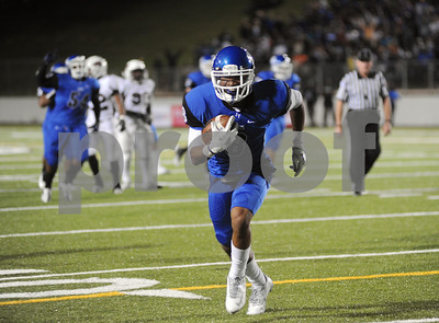 photo by Sarah A. Miller/Tyler Morning Telegraph  John Tyler's senior wide receiver Fred Ross makes a touchdown run in the second quarter during their game against Whitehouse at Trinity Mother Frances Rose Stadium Friday night in Tyler.