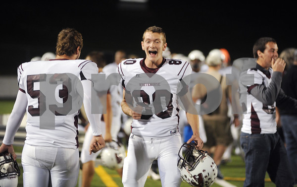 photo by Sarah A. Miller/Tyler Morning Telegraph  Whitehouse's (80) senior Destin Wilkins yells in excitement after a play at the end of the first quarter during their game against John Tyler at Trinity Mother Frances Rose Stadium Friday night in Tyler.