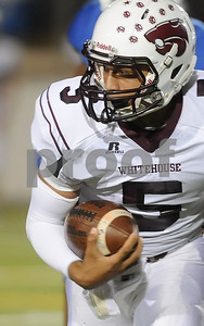 photo by Sarah A. Miller/Tyler Morning Telegraph  Whitehouse's (5) junior Patrick Mahomes gains yardage during their game against John Tyler at Trinity Mother Frances Rose Stadium Friday night in Tyler.