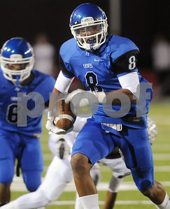 photo by Sarah A. Miller/Tyler Morning Telegraph  John Tyler's senior wide receiver Fred Ross gains yardage during their game against Whitehouse at Trinity Mother Frances Rose Stadium Friday night in Tyler.
