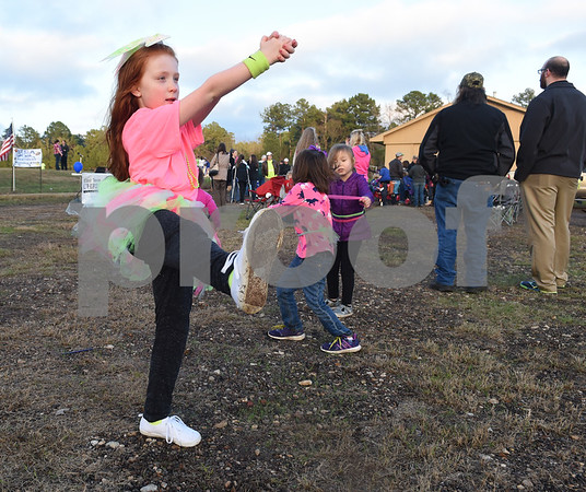 Genesis Sorenson, 8, works on her cheerleading routine before the goal post raising ceremony at East Texas Christian Academy Thursday Jan. 19, 2017. The school is adding 6-man football to its high school and middle school athletic programs for the 2017-2018 school year.   (Sarah A. Miller/Tyler Morning Telegraph)