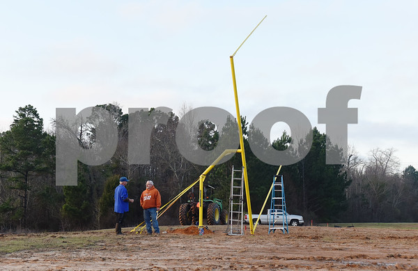 Keith Glass and Phil Cauley talk before the goal post raising ceremony at East Texas Christian Academy Thursday Jan. 19, 2017. The school is adding 6-man football to its high school and middle school athletic programs for the 2017-2018 school year.   (Sarah A. Miller/Tyler Morning Telegraph)