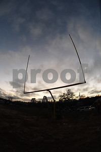 The sun sets as a football goal post is raised at East Texas Christian Academy Thursday Jan. 19, 2017. The school is adding 6-man football to its high school and middle school athletic programs for the 2017-2018 school year.   (Sarah A. Miller/Tyler Morning Telegraph)