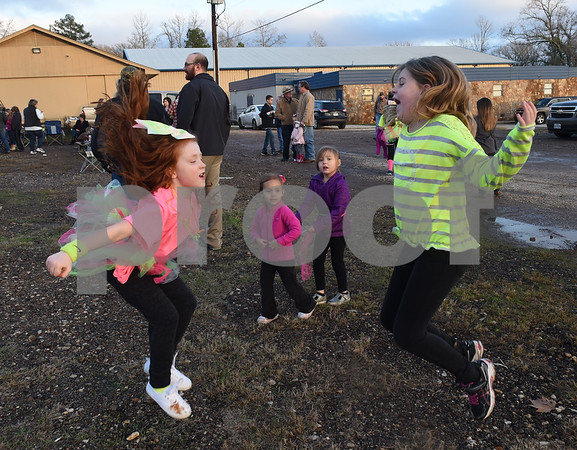 Genesis Sorenson, 8, and Annah Spencer, 9, practice their cheerleading skills before the goal post raising ceremony at East Texas Christian Academy Thursday Jan. 19, 2017. The school is adding 6-man football to its high school and middle school athletic programs for the 2017-2018 school year.   (Sarah A. Miller/Tyler Morning Telegraph)