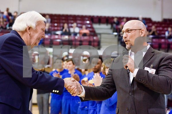C.L. Nix shakes hands with superintendent Dr. Chris Moran during a ceremony recognizing the renaming of Whitehouse's arena to the C.L. Nix Wildcat Arena at Whitehouse High School in Whitehouse, Texas, on Friday, Jan. 19, 2018. The ceremony took place on the 40th anniversary of Coach Nix and the Wildcats winning a state championship in the 2A division in 1978. (Chelsea Purgahn/Tyler Morning Telegraph)