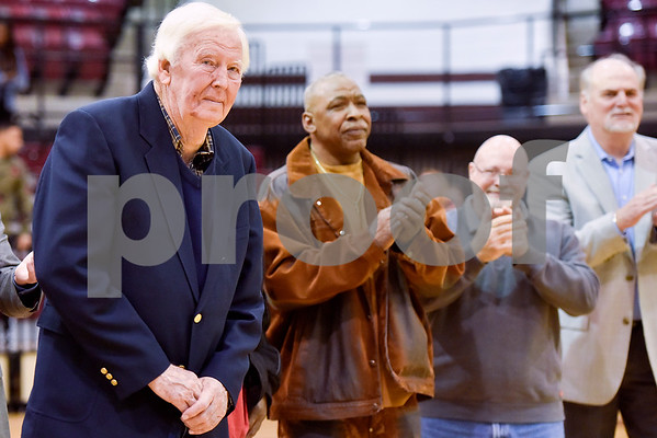 C.L. Nix, left, is recognized during a ceremony recognizing the renaming of Whitehouse's arena to the C.L. Nix Wildcat Arena at Whitehouse High School in Whitehouse, Texas, on Friday, Jan. 19, 2018. The ceremony took place on the 40th anniversary of Coach Nix and the Wildcats winning a state championship in the 2A division in 1978. (Chelsea Purgahn/Tyler Morning Telegraph)