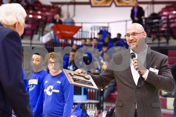 Whitehouse Superintendent Dr. Chris Moran presents C.L. nix with a key to the arena during a ceremony recognizing the renaming of Whitehouse's arena to the C.L. Nix Wildcat Arena at Whitehouse High School in Whitehouse, Texas, on Friday, Jan. 19, 2018. The ceremony took place on the 40th anniversary of Coach Nix and the Wildcats winning a state championship in the 2A division in 1978. (Chelsea Purgahn/Tyler Morning Telegraph)