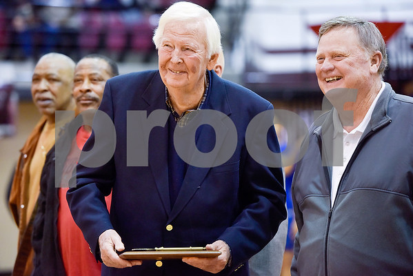 C.L. Nix, center, smiles after receiving a plaque with a key to the arena during a ceremony recognizing the renaming of Whitehouse's arena to the C.L. Nix Wildcat Arena at Whitehouse High School in Whitehouse, Texas, on Friday, Jan. 19, 2018. The ceremony took place on the 40th anniversary of Coach Nix and the Wildcats winning a state championship in the 2A division in 1978. (Chelsea Purgahn/Tyler Morning Telegraph)