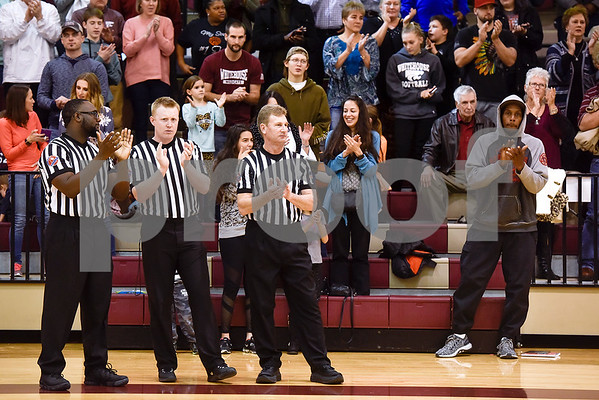 C.L. Nix, not pictured, receives a standing ovation during a ceremony recognizing the renaming of Whitehouse's arena to the C.L. Nix Wildcat Arena at Whitehouse High School in Whitehouse, Texas, on Friday, Jan. 19, 2018. The ceremony took place on the 40th anniversary of Coach Nix and the Wildcats winning a state championship in the 2A division in 1978. (Chelsea Purgahn/Tyler Morning Telegraph)