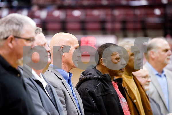 Members of the 1978 championship team stand during a ceremony recognizing the renaming of Whitehouse's arena to the C.L. Nix Wildcat Arena at Whitehouse High School in Whitehouse, Texas, on Friday, Jan. 19, 2018. The ceremony took place on the 40th anniversary of Coach Nix and the Wildcats winning a state championship in the 2A division in 1978. (Chelsea Purgahn/Tyler Morning Telegraph)