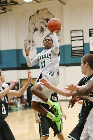 Connally's  Deshawn Riddick takes a shot against Cedar Park at Connally High School on Tuesday.