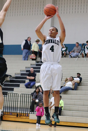Connally's Adrian Williams attempts a 3-point shot against Cedar Park at Connally High School on Tuesday
