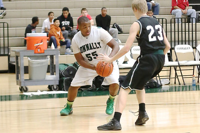 Connally's  Rodney Falanay dribbles at a Cedar Park defender at Connally High School on Tuesday.