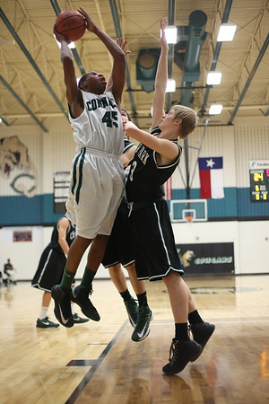 Connally's Roy Jones takes a shot against Cedar Park at Connally High School on Tuesday.