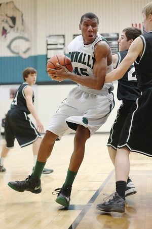 Connally's Roy Jones backs down a defender against Cedar Park at Connally High School on Tuesday.
