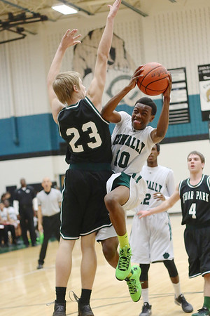 Connally's  Latreal Limuel  drives to the hoop against Cedar Park at Connally High School on Tuesday.