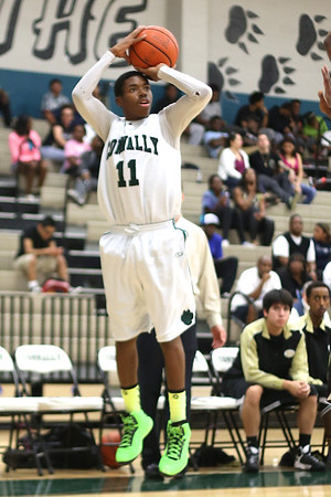Connally's  Deshawn Riddick  attempts a 3-point shot against Lanier at Connally High School on Monday.
