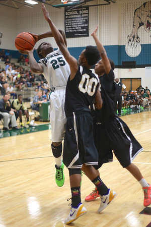 Connally's  Joseph Mitchell takes a shot against Lanier at Connally High School on Monday.