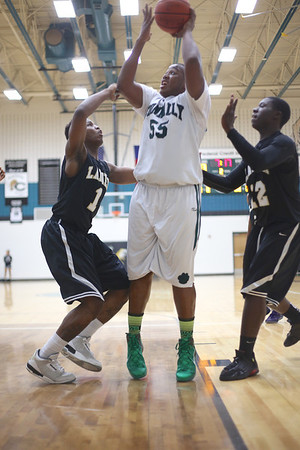 Connally's  Rodney Falanay takes a shot against Lanier at Connally High School on Monday.