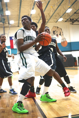 Connally's  Joseph Mitchell posts up against Lanier at Connally High School on Monday.