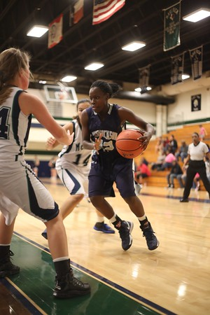 Hendrickson's Jakira Rogers  drives towards the hoop against McNeil Monday at  McNeil High School.