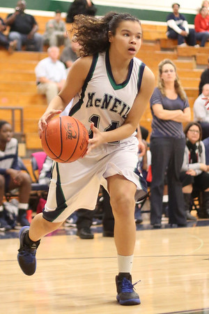 McNeil's Destinee Haywood looks for an open teammate against Hendrickson Monday at  McNeil High School.
