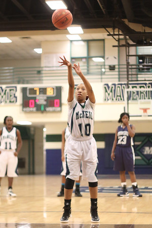 McNeil's Troi Swain shoots a free throw against Hendrickson Monday at  McNeil High School.