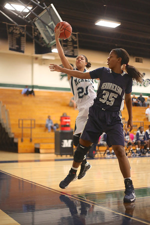 McNeil's Karissa Black corrals a loose ball against Hendrickson Monday at  McNeil High School.