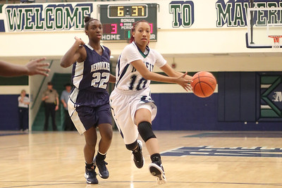 McNeil's Troi Swain drives towards the hoop against Hendrickson Monday at  McNeil High School.