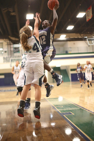 Hendrickson's Jakira Rogers takes a shot against McNeil Monday at  McNeil High School.