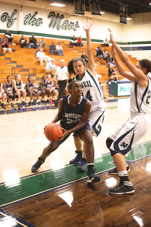 Hendrickson's Kiana Marti battles with McNeil defenders Monday at  McNeil High School.