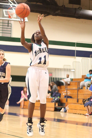 McNeil's Diamond Caro takes a 3 point shot against Hendrickson Monday at  McNeil High School.