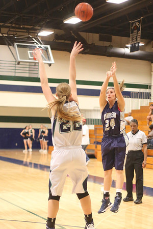 Hendrickson's Manah Meyer takes a 3 point shot against McNeil Monday at  McNeil High School.