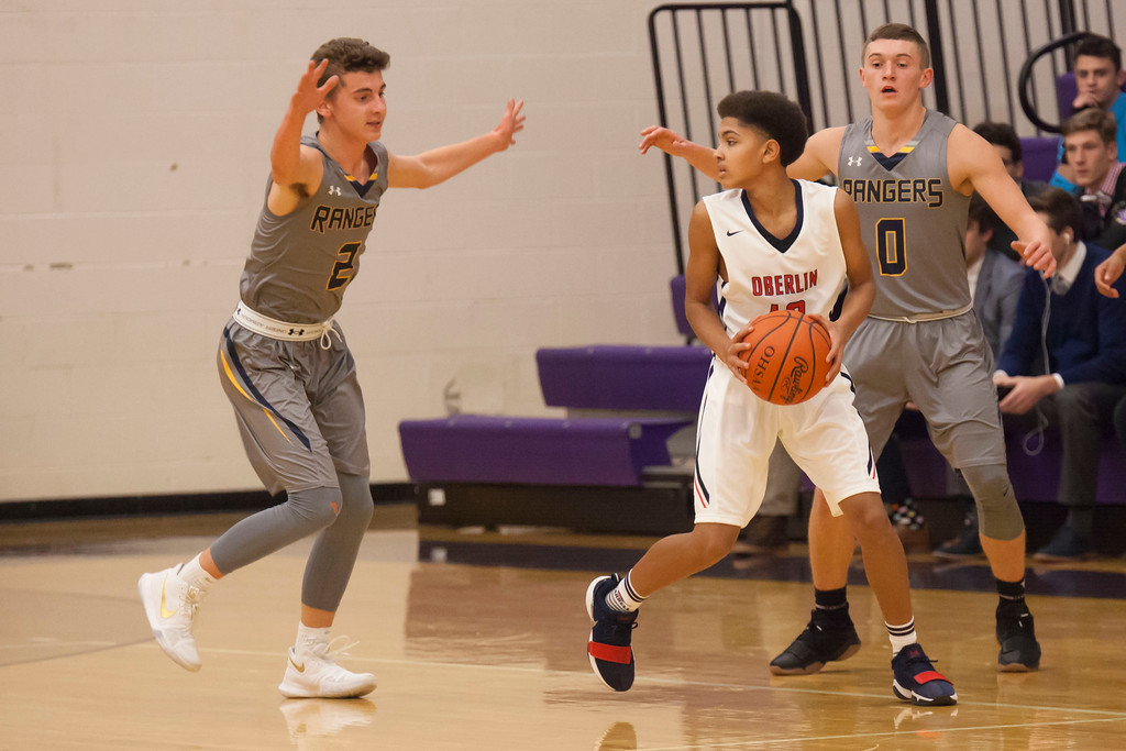 . Oberlin\'s Giles Harrell looks for help as North Ridgeville\'s Scoti Millgard, left, and MJ Smith double up on defense.Jen Forbus -- The Morning Journal