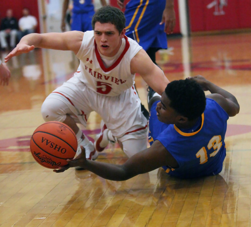 . DeAri Todd of Clearview and Josh Filkill of Fairview dive after a loose ball during the first quarter. Randy Meyers -- The Morning Journal