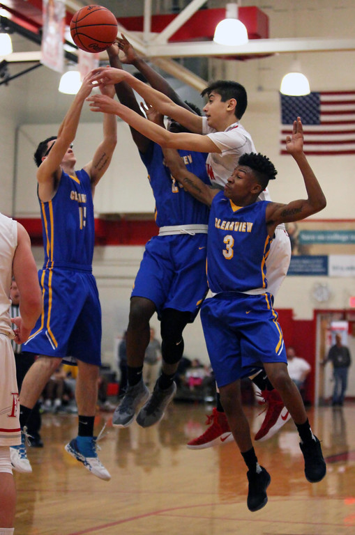 . Clearview\'s jaylen Paschel, from left, Jonathan Coutch and Jamel Billings battle Fairview\'s Grant Howes for a rebound in the second quarter. Randy Meyers -- The Morning Journal