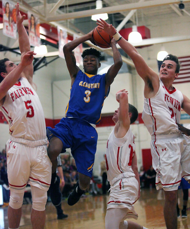 . clearview\'s Jamel Billings drives through Fairview\'s Josh Filkill and Grant Howes. Randy Meyers -- The Morning Journal