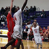 Oberlin's Mark Robinson drives past Jimmy Clark of Hawken on a fast break. Randy Meyers -- The Morning Journal