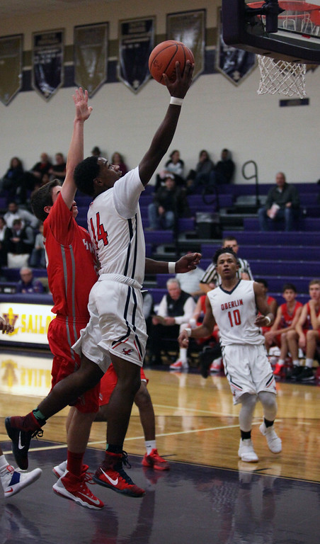 . Oberlin\'s Mark Robinson drives past Jimmy Clark of Hawken on a fast break. Randy Meyers -- The Morning Journal