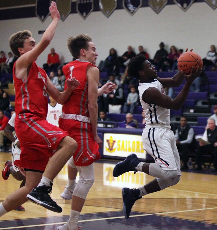 . Oberlin\'s Devan Yarber leads a fast break, pursued by Anderson Clyde and Brendan Paul of Hawken. Randy Meyers -- The Morning Journal